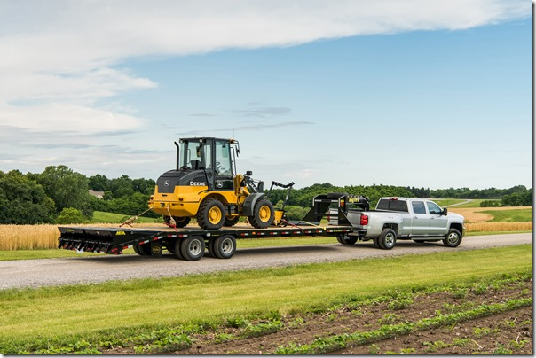 2018 Silverado 3500 HD Silver Ice Metallic LT Crew Cab towing John Deere Wheel Loader with a Big Tex Trailer. Towing 20,225 pounds (total weight of trailer and equipment combined).