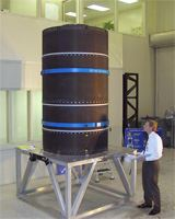 A finished cryogenic tank has exceptionally low porosity and voids, enabling it to effectively contain the low-temperature fuel.