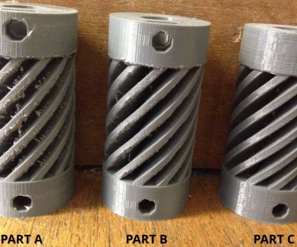 Three 3D-printed couplings illustrating 3D printing resolution differences