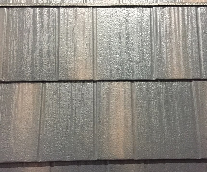 Edco's engineering team had to come up with a way to make the metal shingles feel and look like they had granules on them.