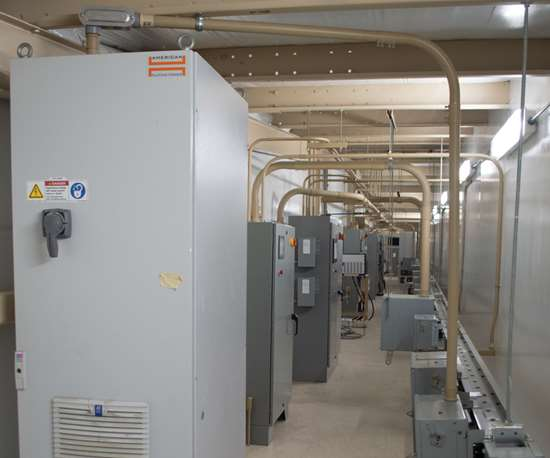 Sun Glo partnered with American Plating Power to design an area that kept rectifiers, control cabinets, heat exchangers and pumps in a separate room on the end of the facility.