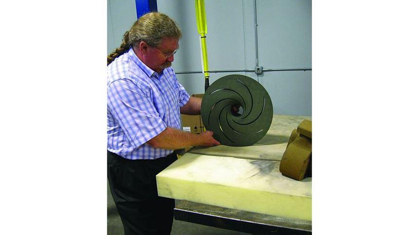 Steve Murray shows a sand mold component