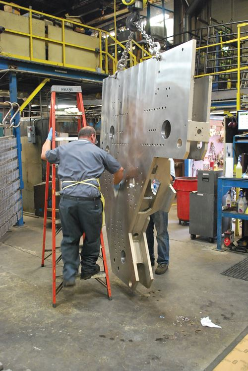 employee and large metal plate