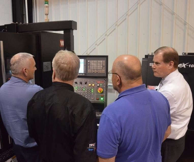 JTEKT Toyoda open house attendees at a machine tool