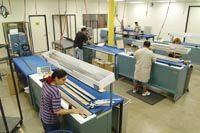 Roll-wrap golf shafts
