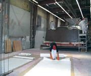 Technicians lay uphull mold