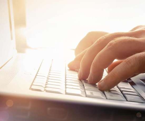 fingers typing stock photo