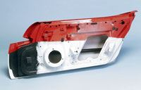 Bonded and painted door module, showing the hinge area where carbon fiber SMC adds strength and stiffness.
