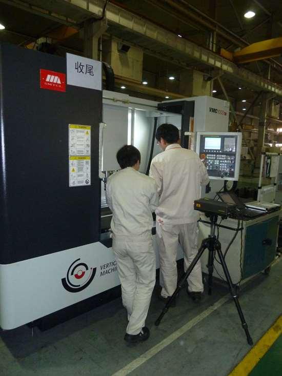 technicians use a laser scanner