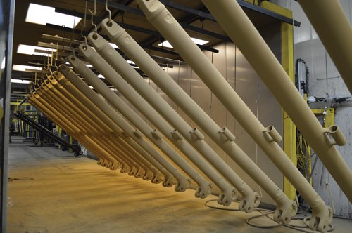 Parts for military components are powder coated in Burkard Industries facilities in Detroit.