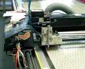 Mid-film scrim with parallel aramid fibers added to standard Gatorback
