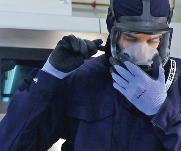 worker putting on a mask