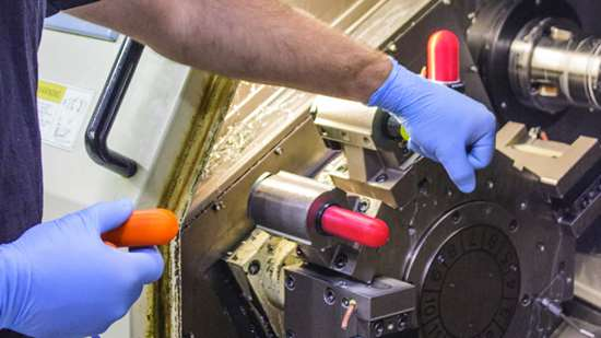 Operator Machinist Daren Johnson installs tool covers in one of Swiss Automation's Eurotech turning centers.