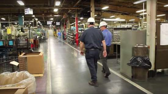 two ATS employees in a customer facility