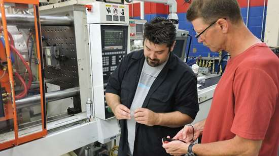 Kevin Klotz (on right), MGS senior project engineer for simulation services, and Darin Von-Asten, MGS sampling process technician
