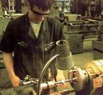 An 11th-grade student works on project