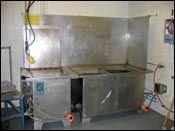 An ultrasonic wash tank