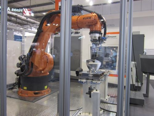 For this demonstration, the robot performed both workpiece pallet changeout and simulated polishing operations of machined parts.
