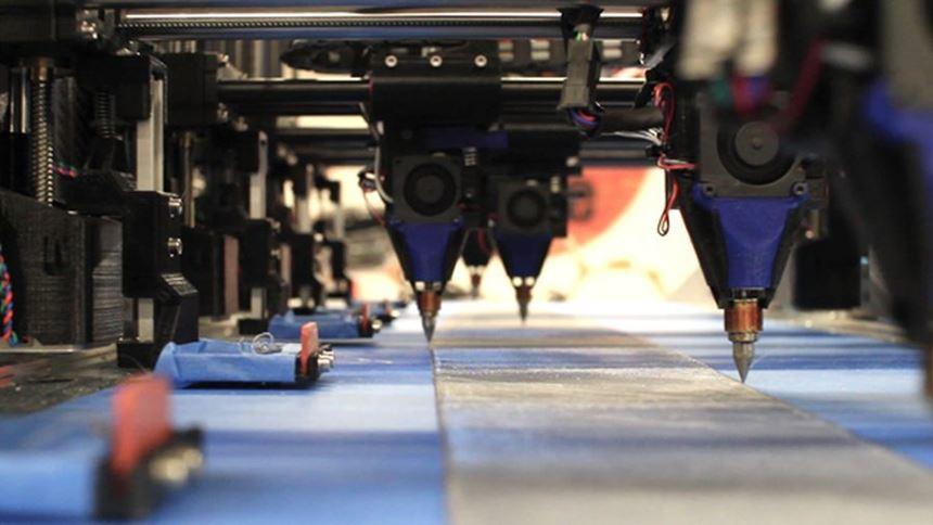 Multi-head additive manufacturing