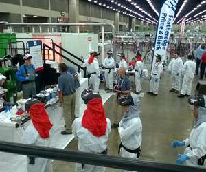 Students line up to start testing their painting skills at SkillsUSA in Louisville, Kentucky.