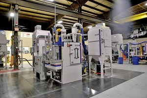 grit blasting machine includes a reclaim system and dust collector