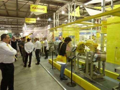 FANUC's booth displaying robotic arms