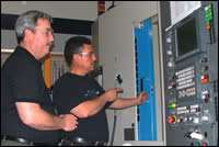 Brad Hart (left) and cell operator Alex Montiel
