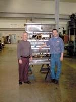 CDM vice president Brian Priestaf (left) and toolmaker Joe Romanski