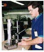 CNC surface grinder operator