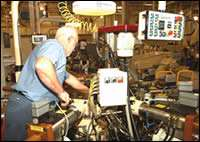 Camcraft's operator Pat McEvoy closely monitors the machine's operation