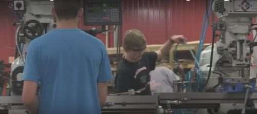 school kids working in a machine shop