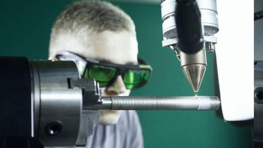 Powder-fed nozzle on Evo welding system