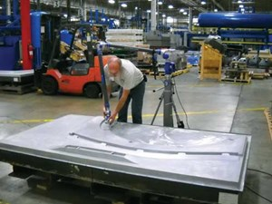 Horizontal mill cuts and measures large molds