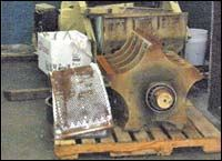 Fine separators mounted atop a feed hopper