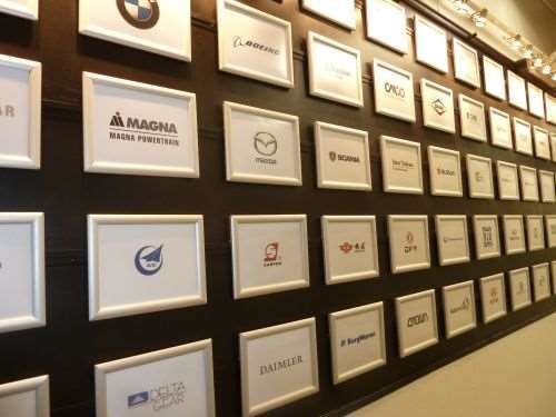 Plaques naming just a few of Gleason's industry partners line the wall of the main hallway leading to the R&D department and manufacturing floor.