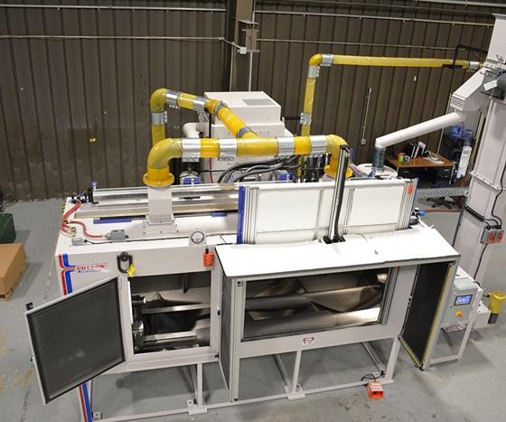 Guyson Corp. custom grab bar peening machine.