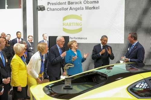 Obama and Merkel at Harting booth