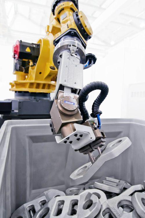 Small-workpiece-handling robotic system.