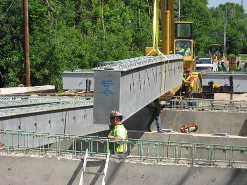 Hybrid-composite bridge beams