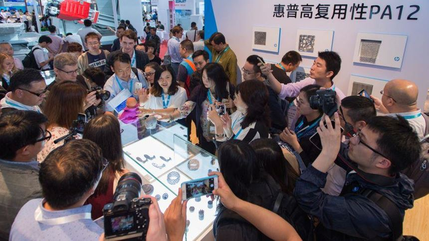 Attendees at Die and Mould China visit the HP Booth and view parts printed with the HP Jet Fusion 3D Printing Solution