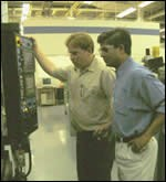 Kevin Berry and Edwin Gasparraj oversee a milling cycle