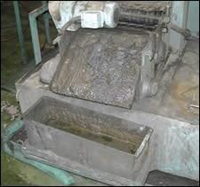 Loose sludge being deposited in a bin