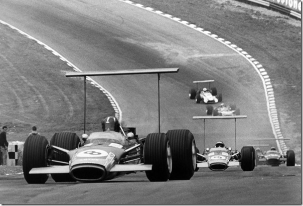 1968 British Grand Prix.Brands Hatch, Great Britain. 20 July 1968.Graham Hill, Lotus 49B-Ford, retired, leads Jackie Oliver, Lotus 49-Ford, retired, and Jo Siffert, Lotus 49B-Ford, 1st position, action.World Copyright: LAT PhotographicRef: Autosport b&w print