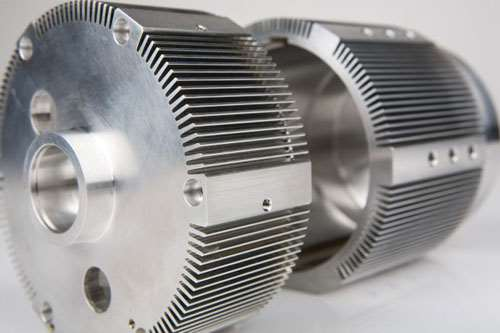 Motor housing with machined fins