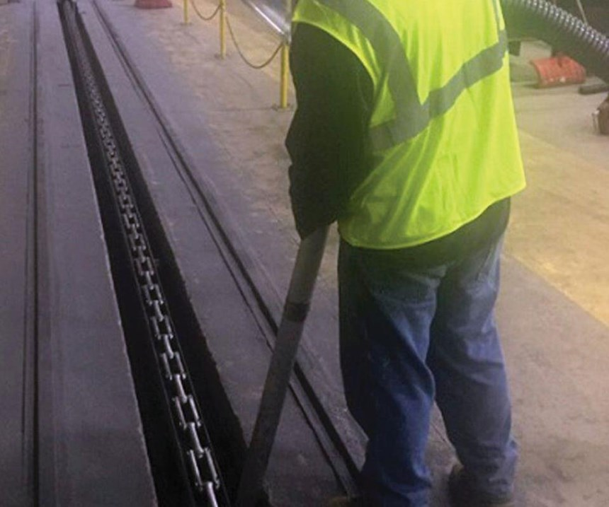 cleaning track auger