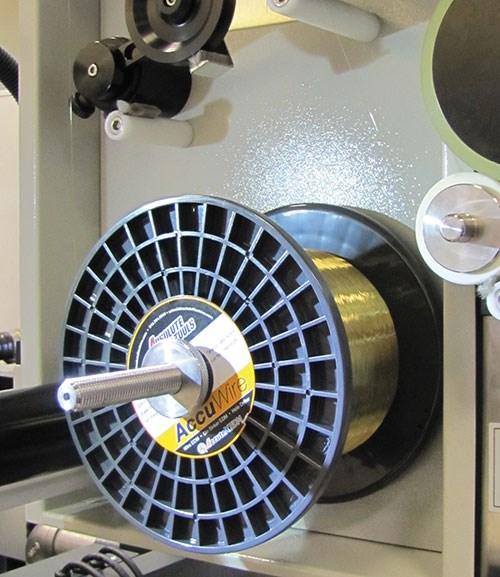 22-pound spool of wire on an EDM wire machine