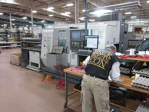 Okuma LM turning center with LNS bar feeder