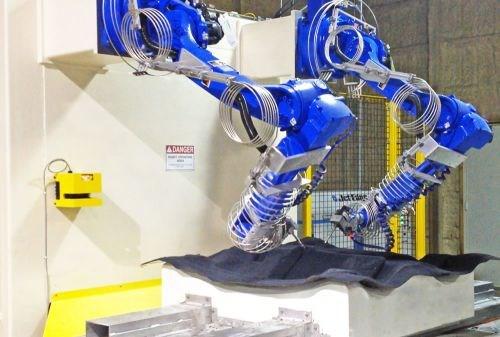 Jet Edge intensifier pumps for robotic waterjet cells