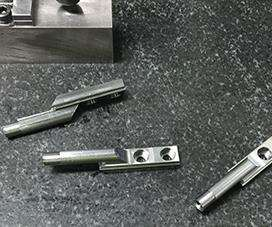 One of the company's principle production  parts is a bolt carrier key for the bolt carrier assembly on an AR rifle.