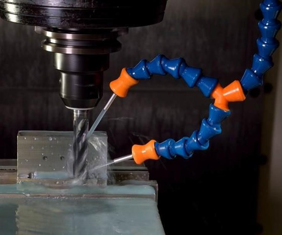 Coolant nozzles provide stable spray pattern for machining